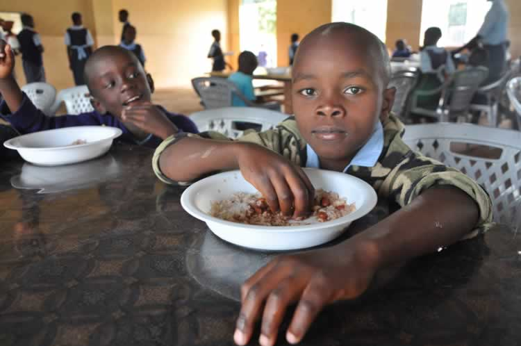 Hungry child eating, Horn of Africa
