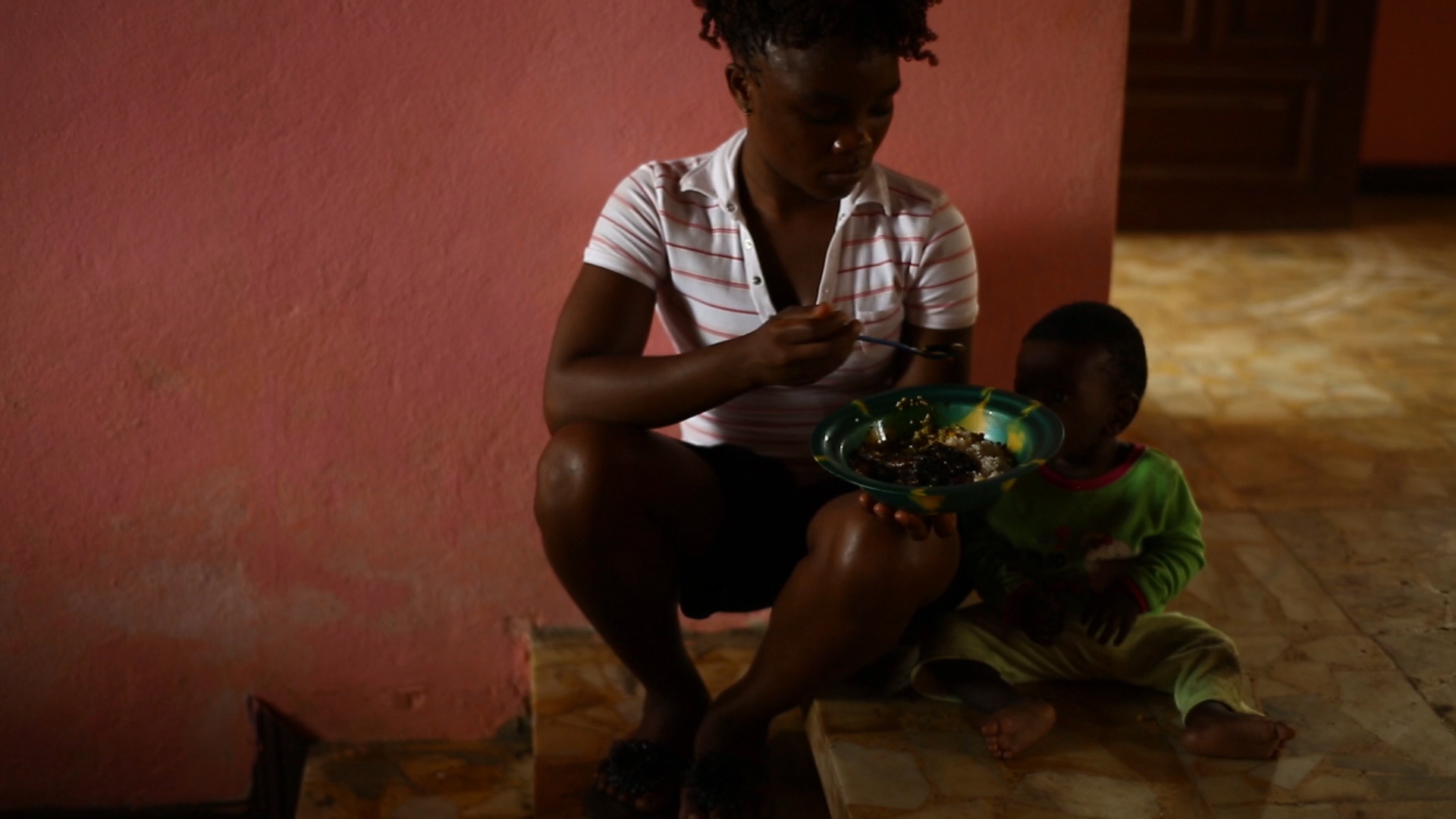 Ebola survivor Decontee Davis cares for a child who has been in contact with an Ebola patient